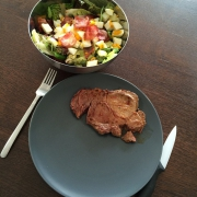 Mixed salad with a beacon / egg topping and a beef steak. Classic after workout meal. #getsomeproteins